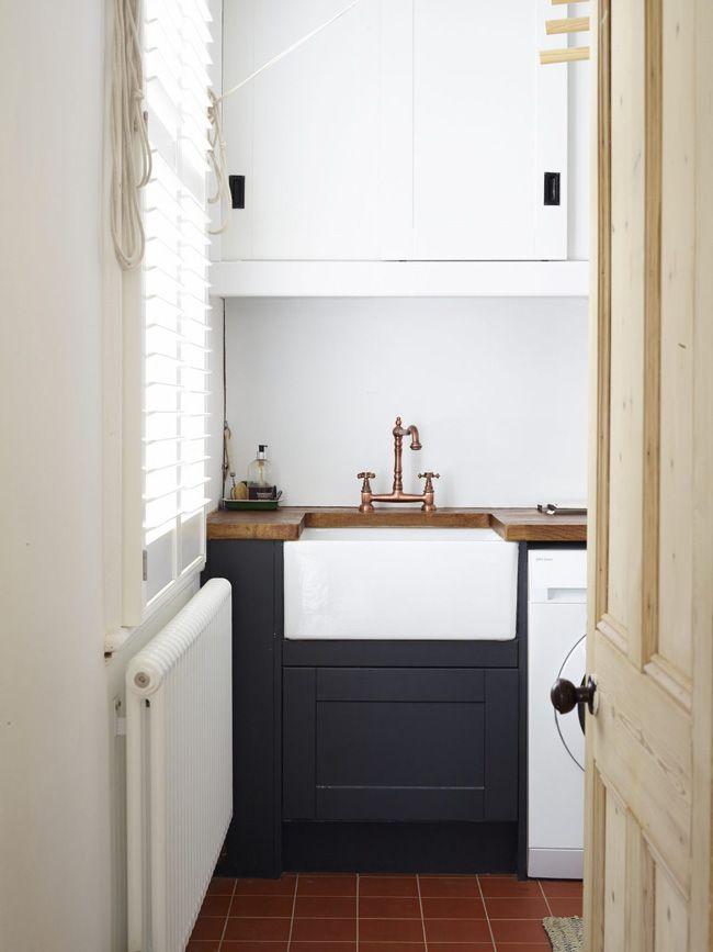 Copper faucet, porcelain sink, and butcher block counter ...