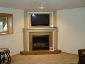 Fireplace Mantels and Surrounds with a tv above Tv Over