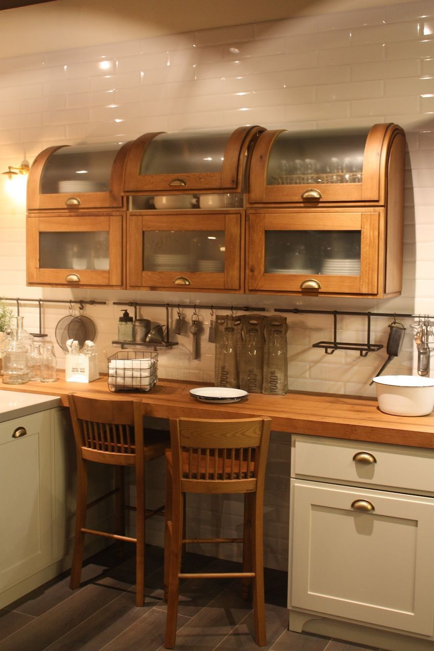 Paired with traditional painted wood kitchen cabinets