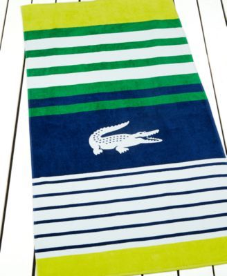 Stake your space at the beach or your place at the pool with this iconic Lacoste towel. Crafted of cotton, the classic croc and a smart striped design will always secure a stylish spot for you. | Cott
