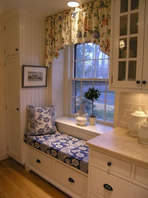 Window seat in a kitchen...comfy place for the kids to sit and talk while you're cooking dinner/doing dishes.