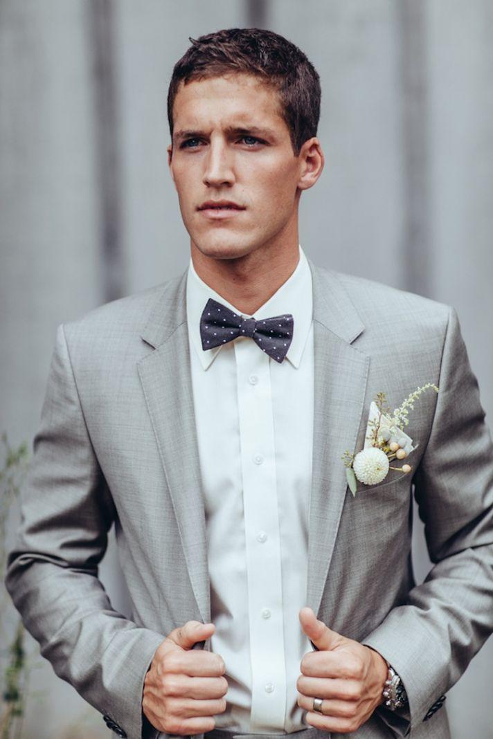 dapper real groom in suit graysuit bowtie groom the