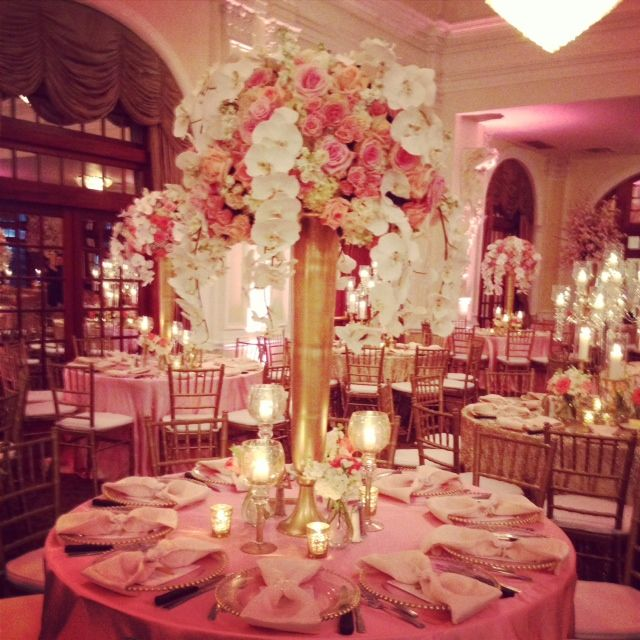 Pink coral champagne and gold centerpiece phalo orchids