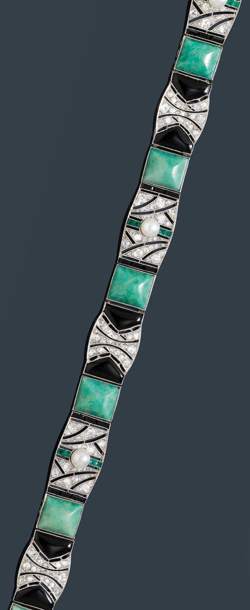 JANESICH - AN ART DECO PLATINUM, AMAZONITE, ONYX, PEARL AND DIAMOND BRACELET, CIRCA 1925. #Janesich #ArtDeco #bracelet