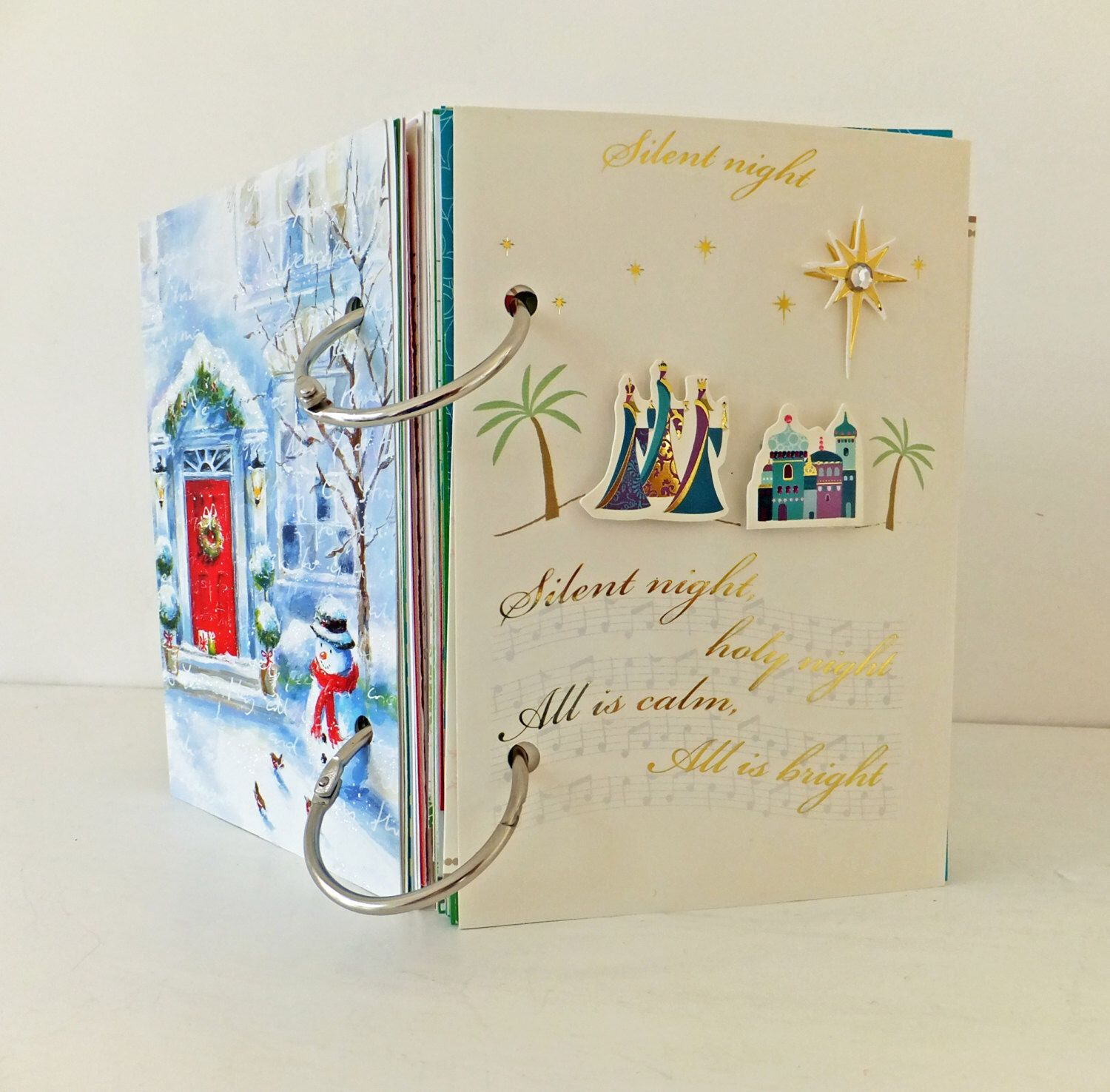Christmas Smash Book, Mixed Paper Journal. Eco-friendly Christmas Journal. Rescued Paper Notebook. Recycled. Upcycled Art Journal by PeonyandThistle on Etsy https://www.etsy.com/listing/208843051/christmas-smash-book-mixed-paper-journal