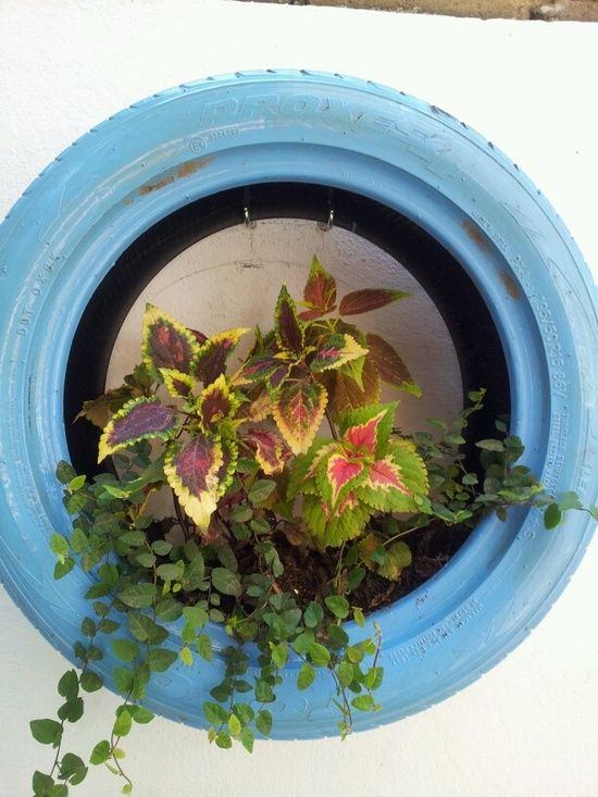 Painted tire wall planter second chance ideas repurposed - Painted tires for gardens ...