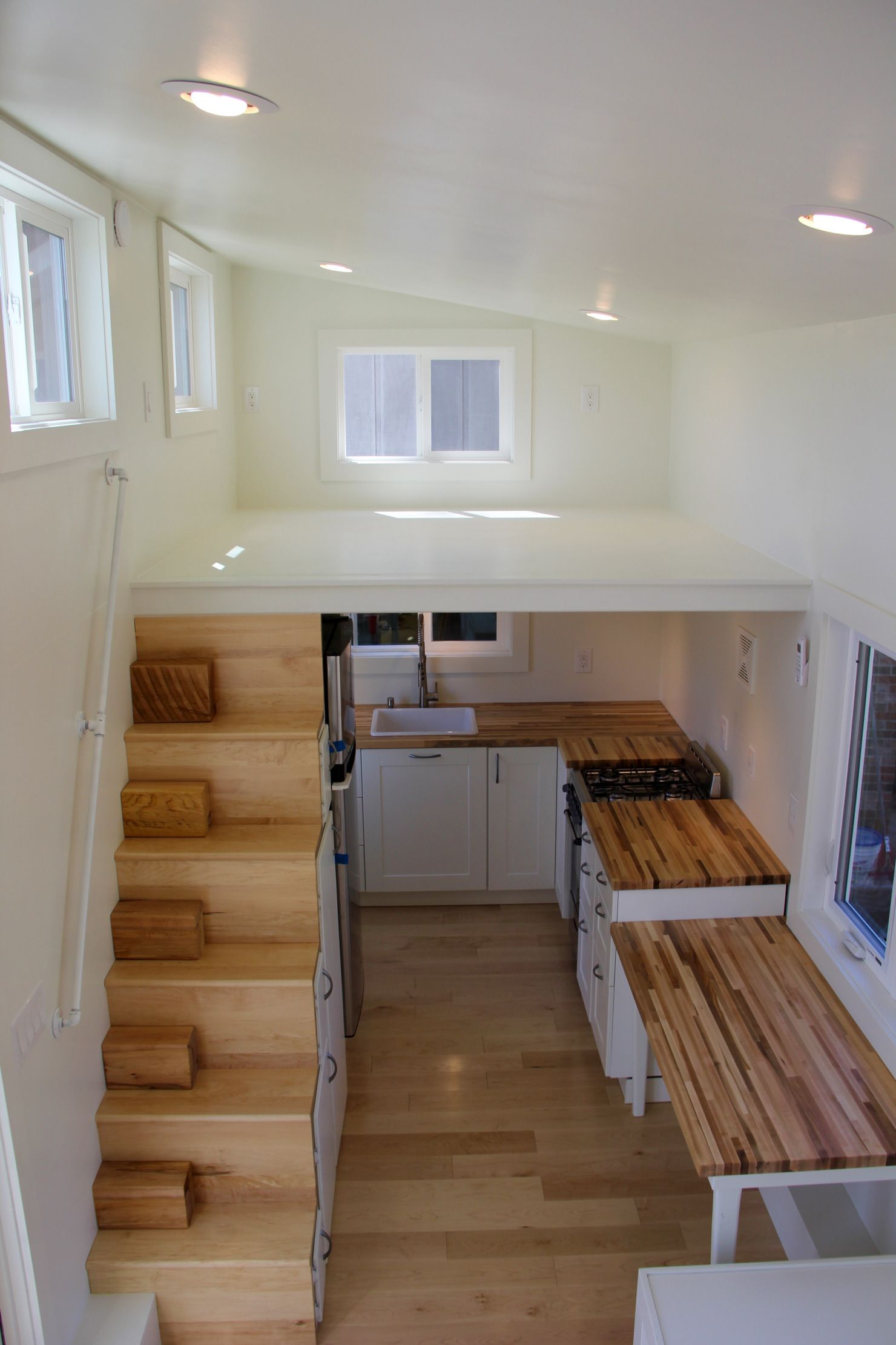 home interior design stairs%0A The Chickadee tiny home is an       design featuring two lofts  stair storage