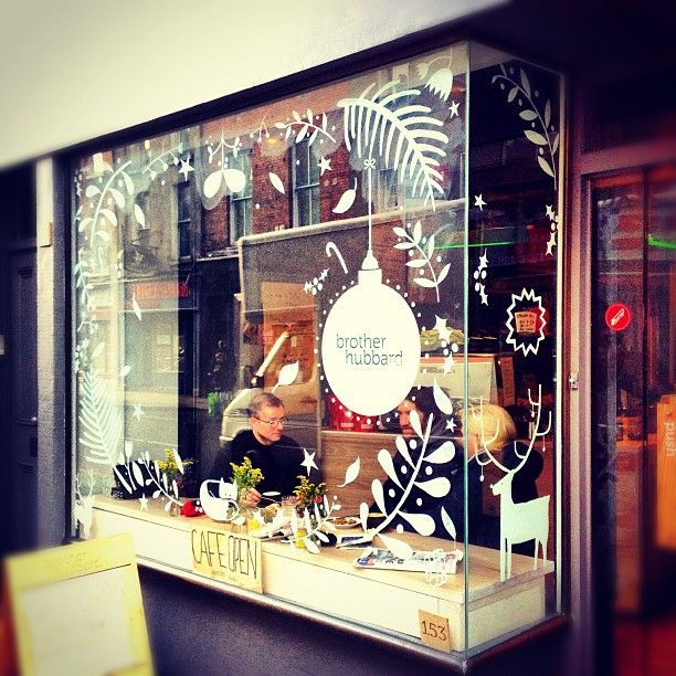 I painted the window of the very lovely cafe Brother Hubbard for Christmas!  Photo by Architexture.
