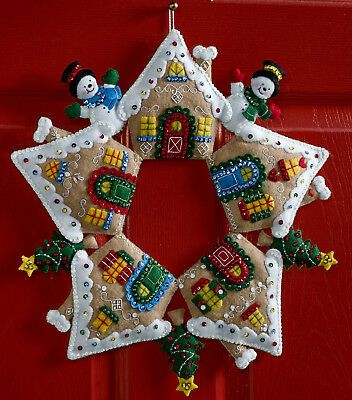Bucilla felt applique kits are a Christmas tradition. At first glance or from a distance you might think this was a star wreath but what would be the points of a star are actually the peaked roofs of the 5 Gingerbread houses that make up this wreath.