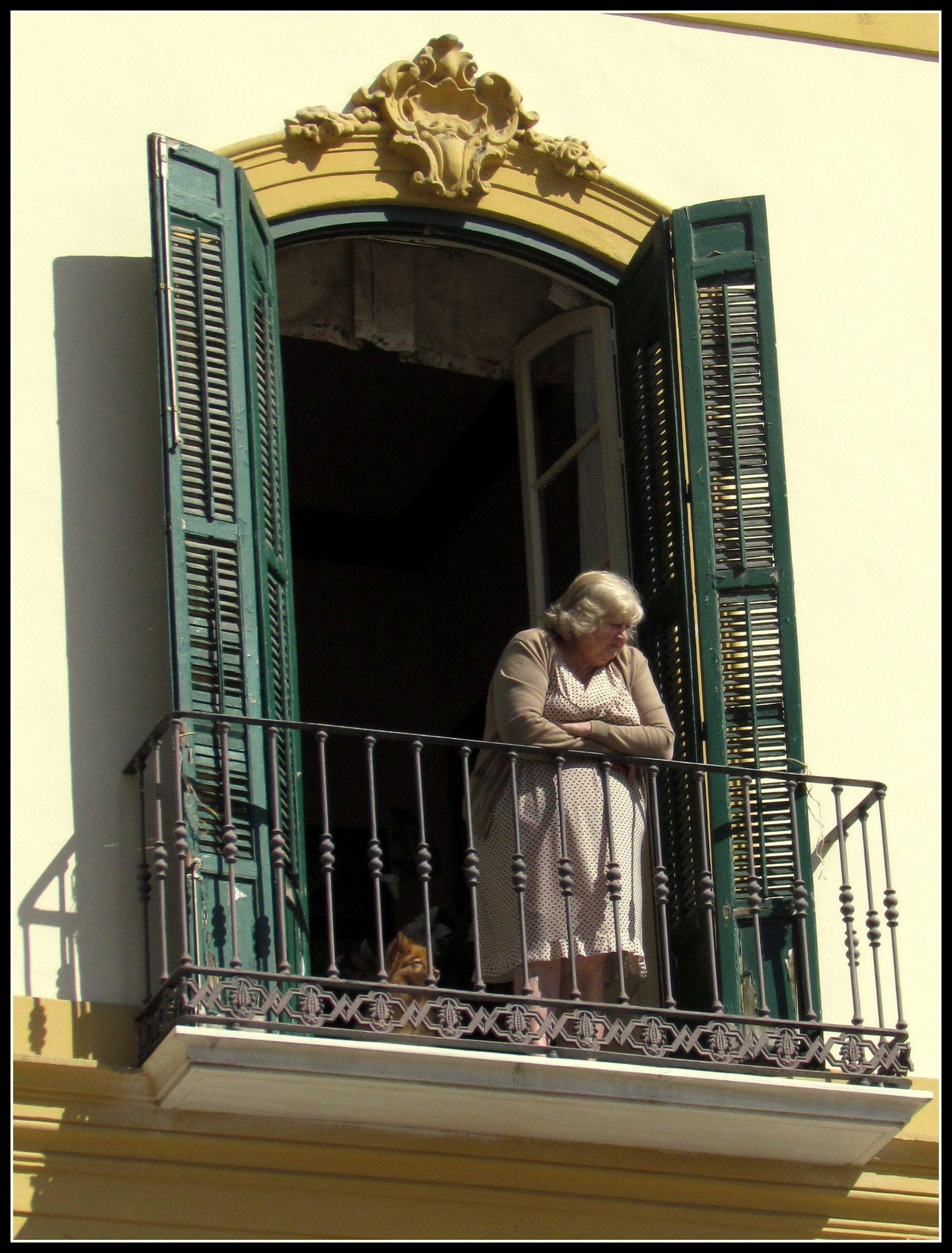 A señora and her dog on the balcony, Malaga, Spain Copyright: Frank Lisborg