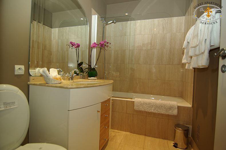Enjoy the adjoining marble bathroom