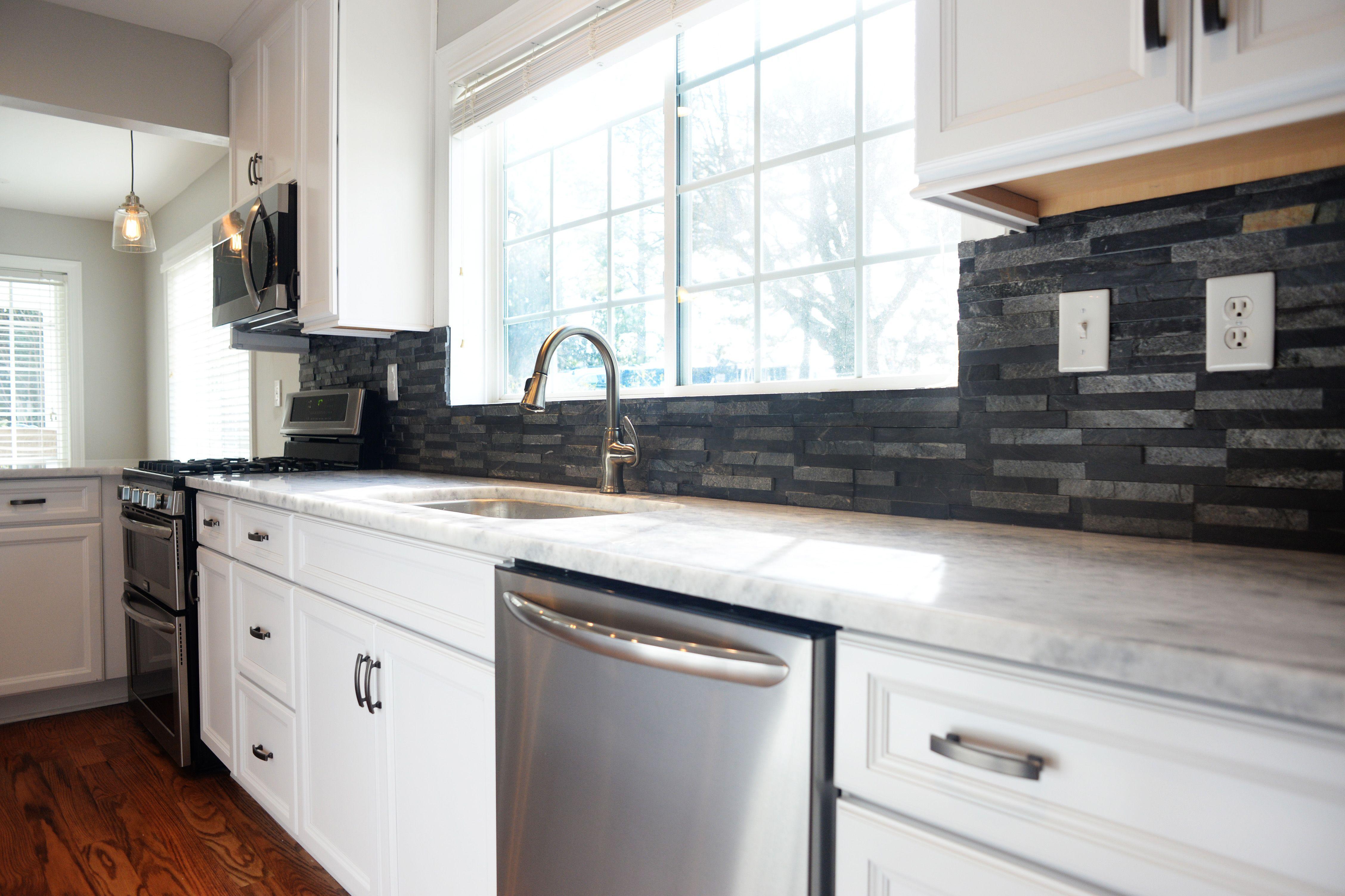 Gray stacked stone backsplash white kitchen Concord