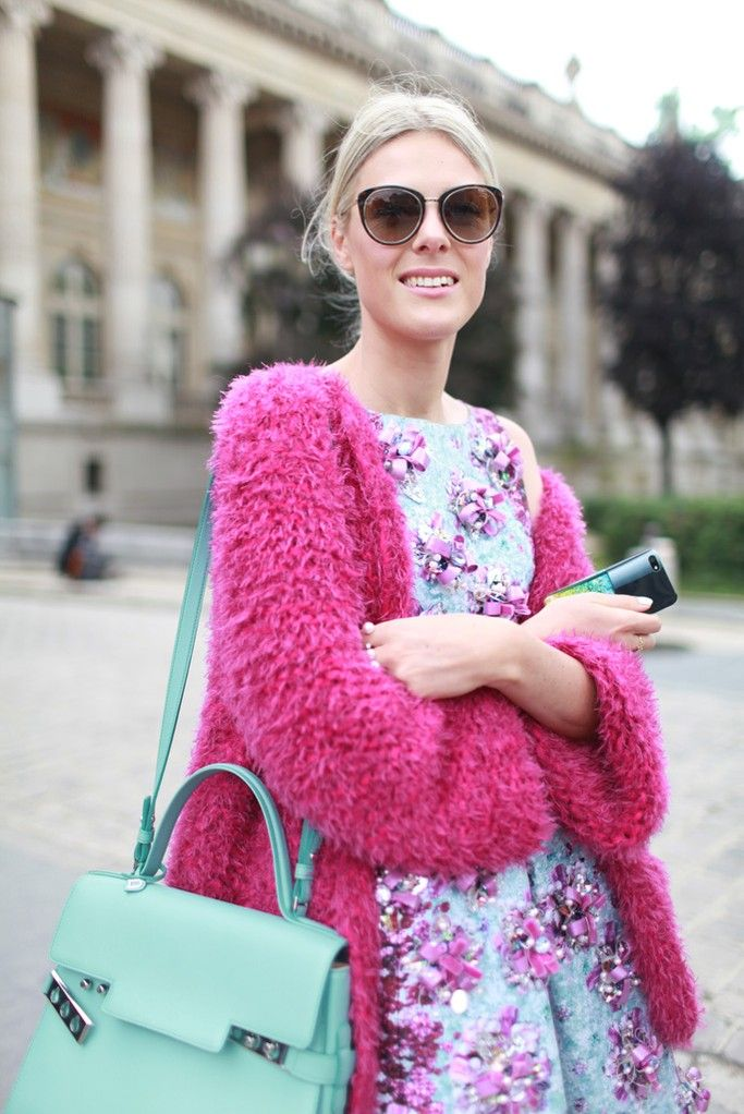 Bright in a pink cardigan and floral Mary Katrantzou dress. Paris #HC #FW14