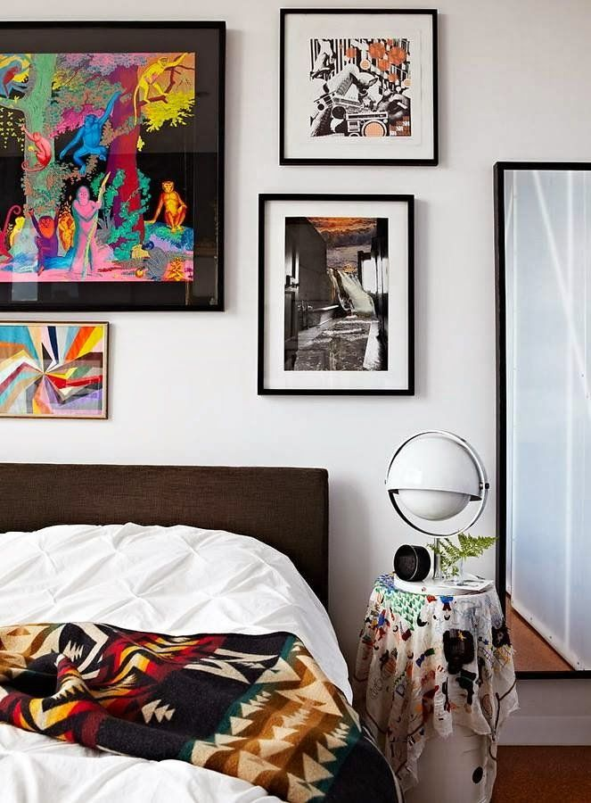 funky bedroom with gallery wall of art