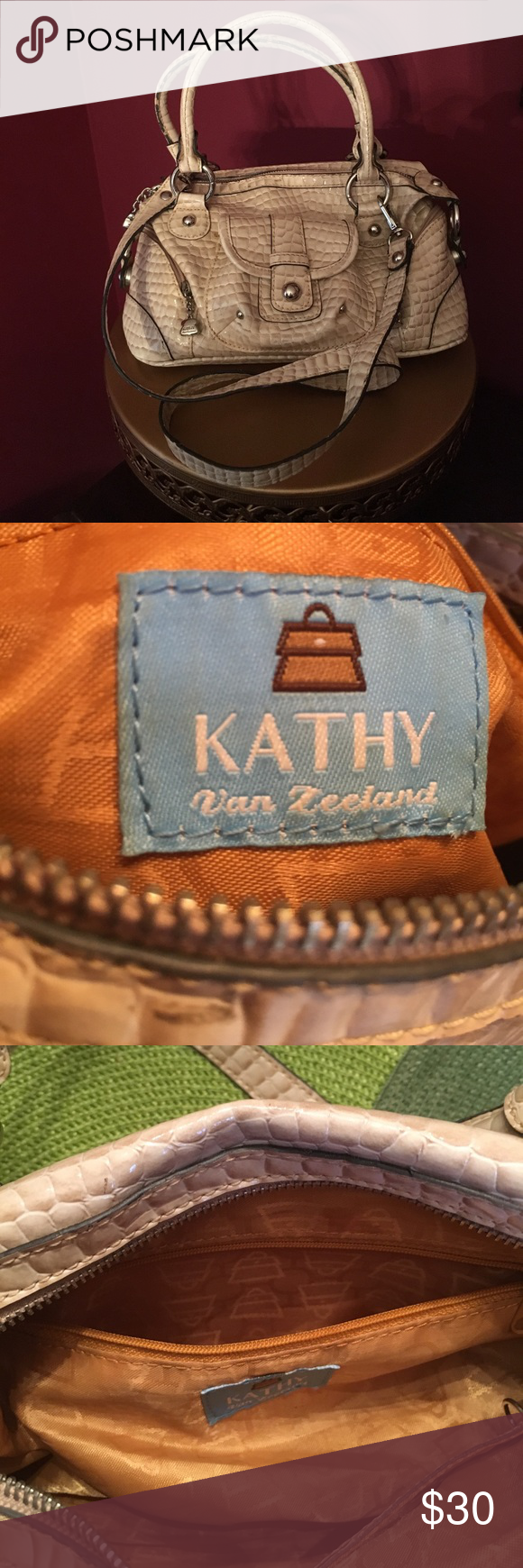 Kathy Van Zeeland Snake-print Handbag Cream and tan snake print Kathy Van Zeeland bag. Detachable, over the shoulder strap. 3 outside compartments. Zip close opening. Inside zippered compartment. All silver look hardware. Great condition. Kathy Van Zeeland Bags Shoulder Bags
