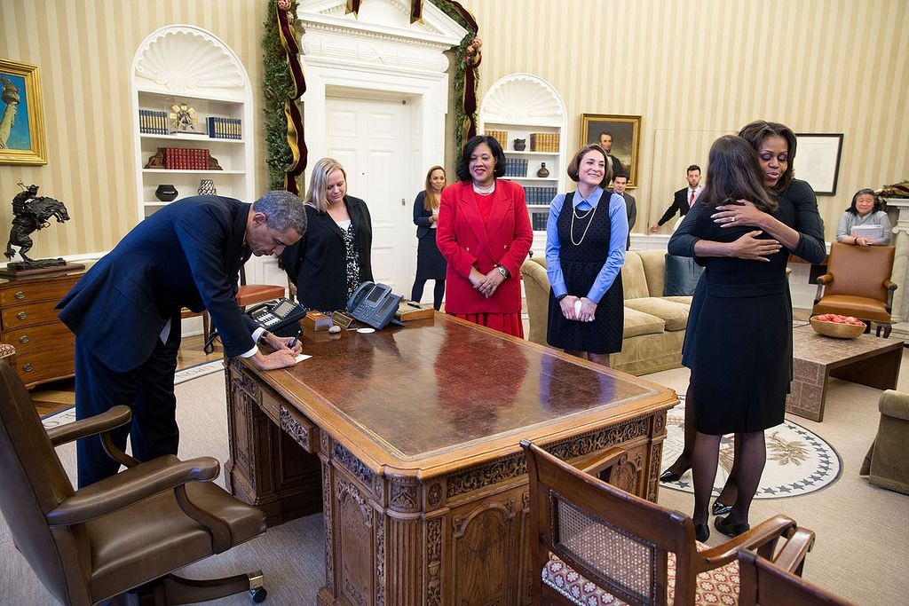 president barack obama signs items at the resolute desk after he and rh pinterest ca