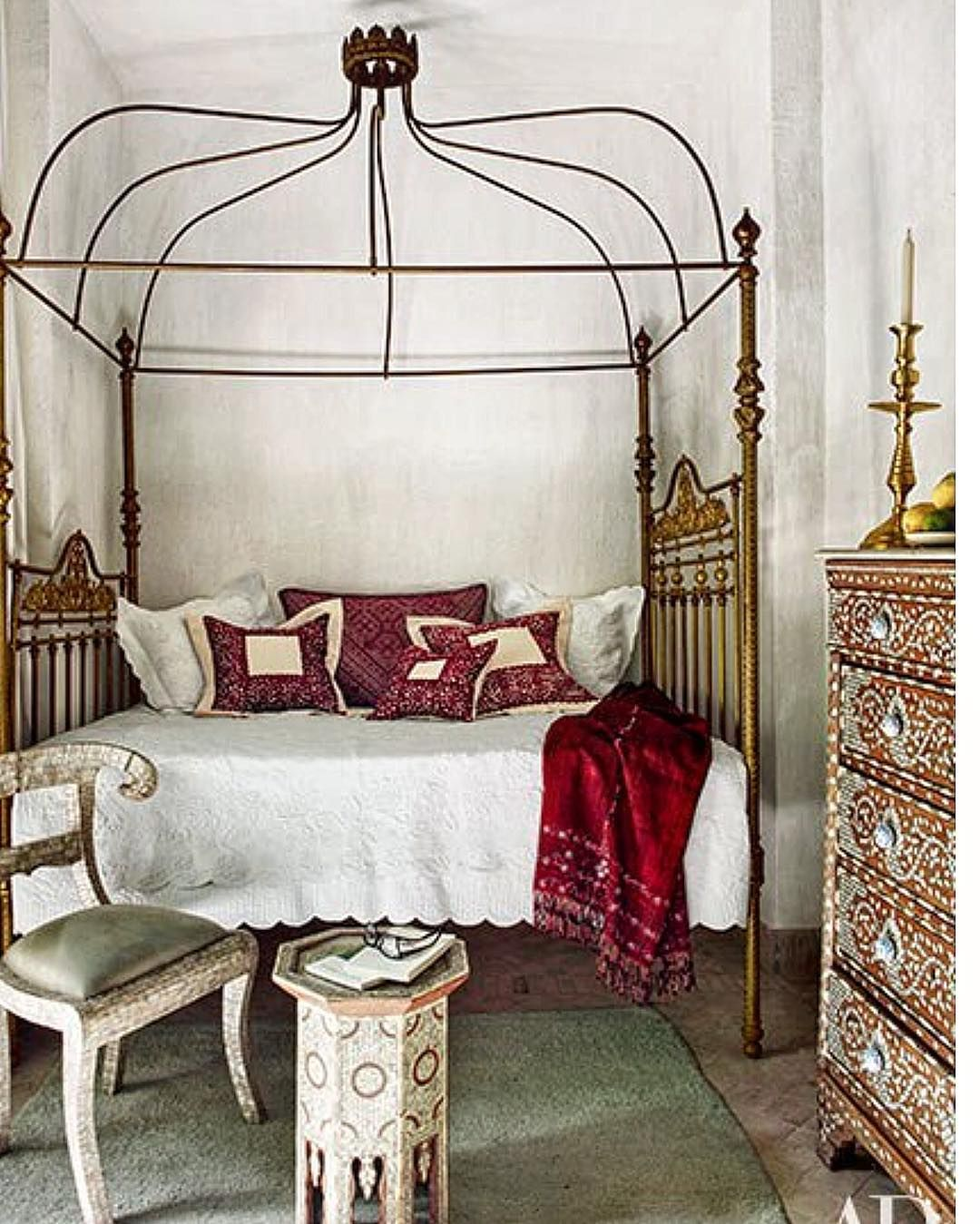 In a bedroom embroidered pillows from Fez