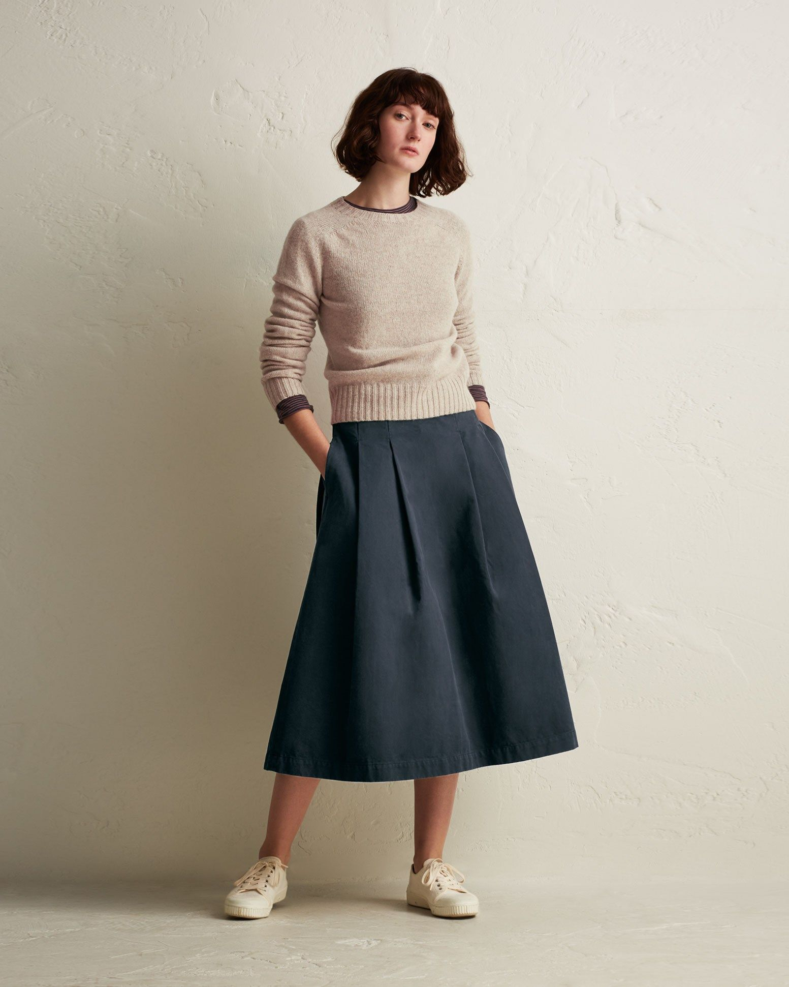 7f42b00d6a Mid-length pleated skirt in a garment-dyed, peachy cotton twill. Fits  neatly over the waist and hips with the pleats opening out below. Pockets.