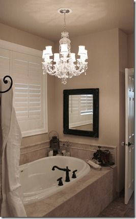 Love this idea we have a standard recessed light above for Master bathroom fixtures
