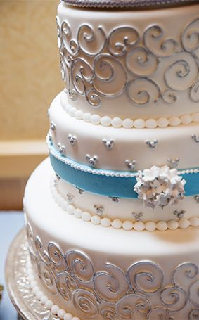 Consider Elegant Details With Touches Of Silver For Your Disney Wedding Cake