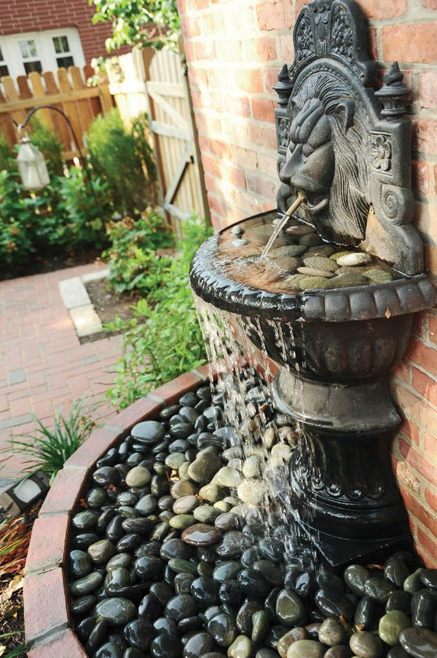 Cool garden fountain filled with pebbles Having