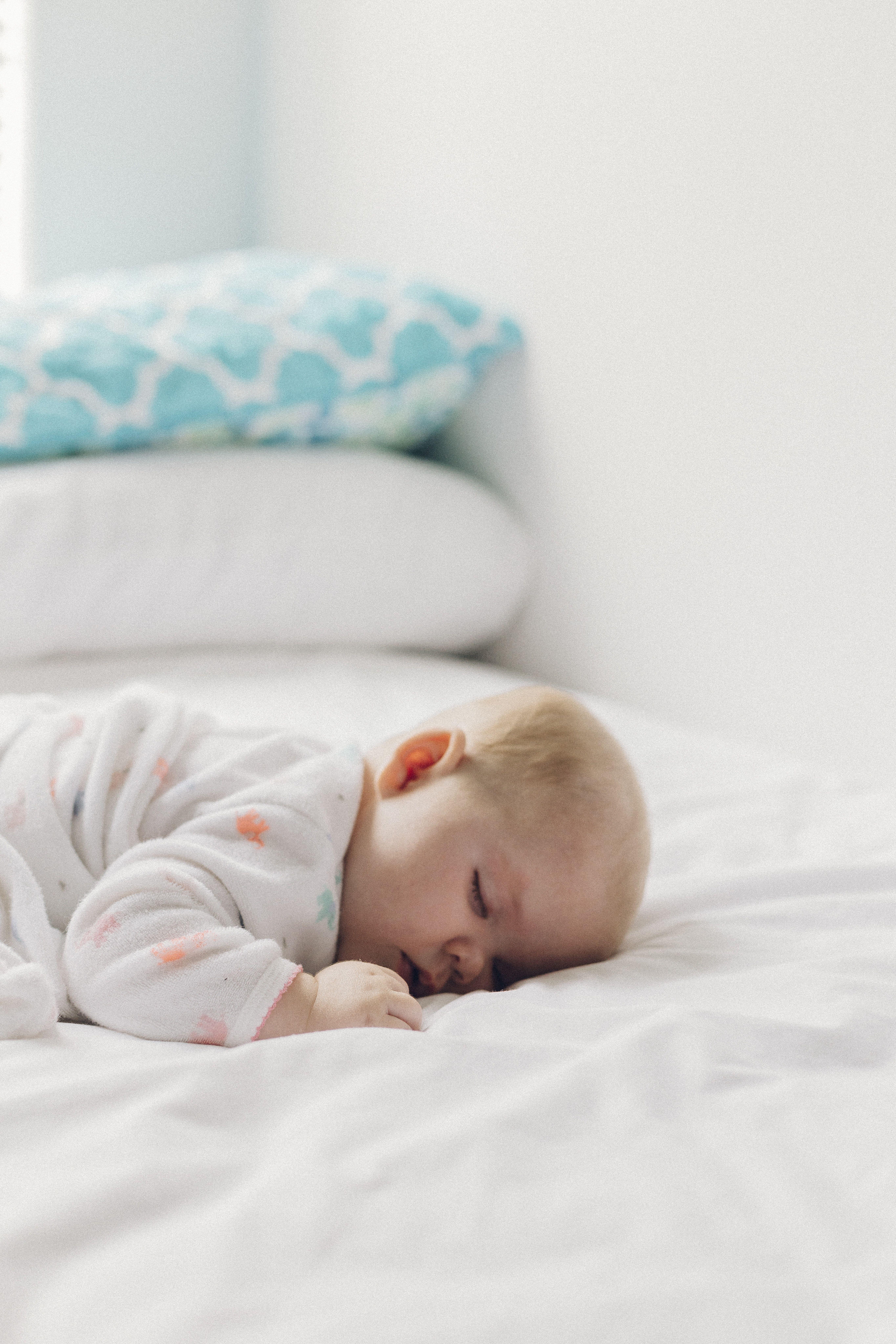 A Baby Sleeping Peacefully On A Bed Baby Sleep Kids Sleep Baby