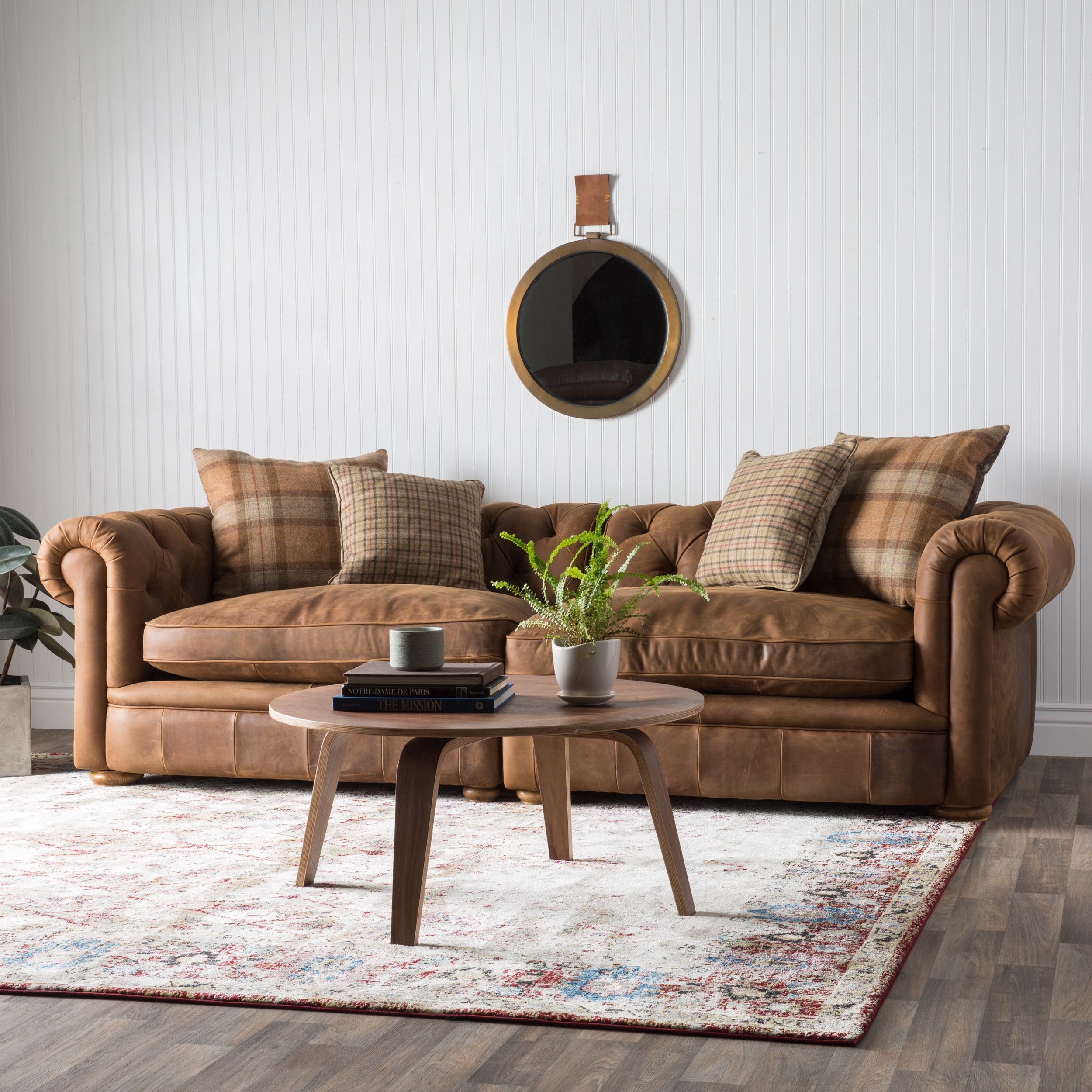 This tufted back grand sofa will complete your home decor with warm tones and a premium kiln dried hardwood frame