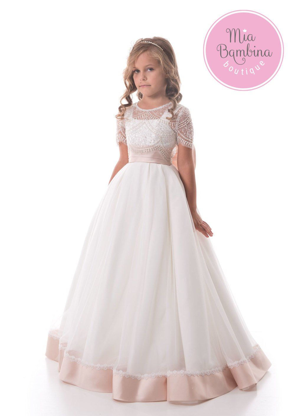c64b5caab4f A beautiful princess dress for flower girls from 3 year to 14 years old.  The tulle lace gown features a lace overlay bodice