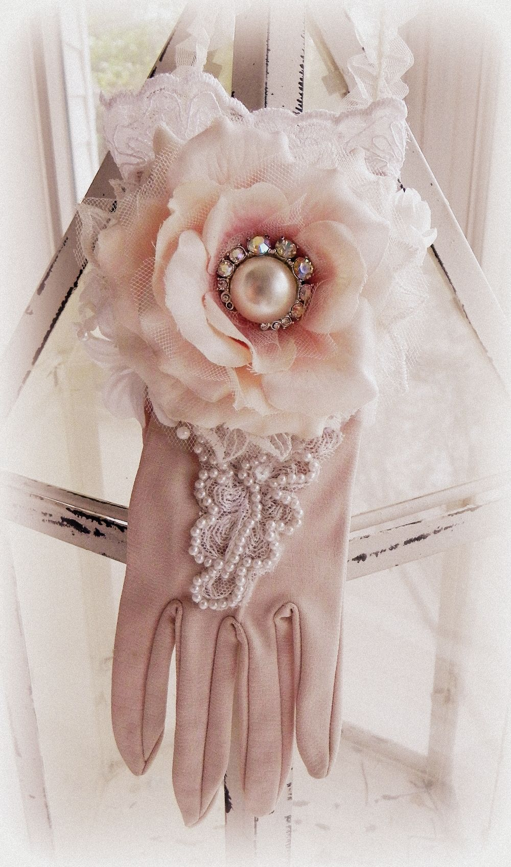 altered vintage glove.... rosette features a beautiful vintage earring