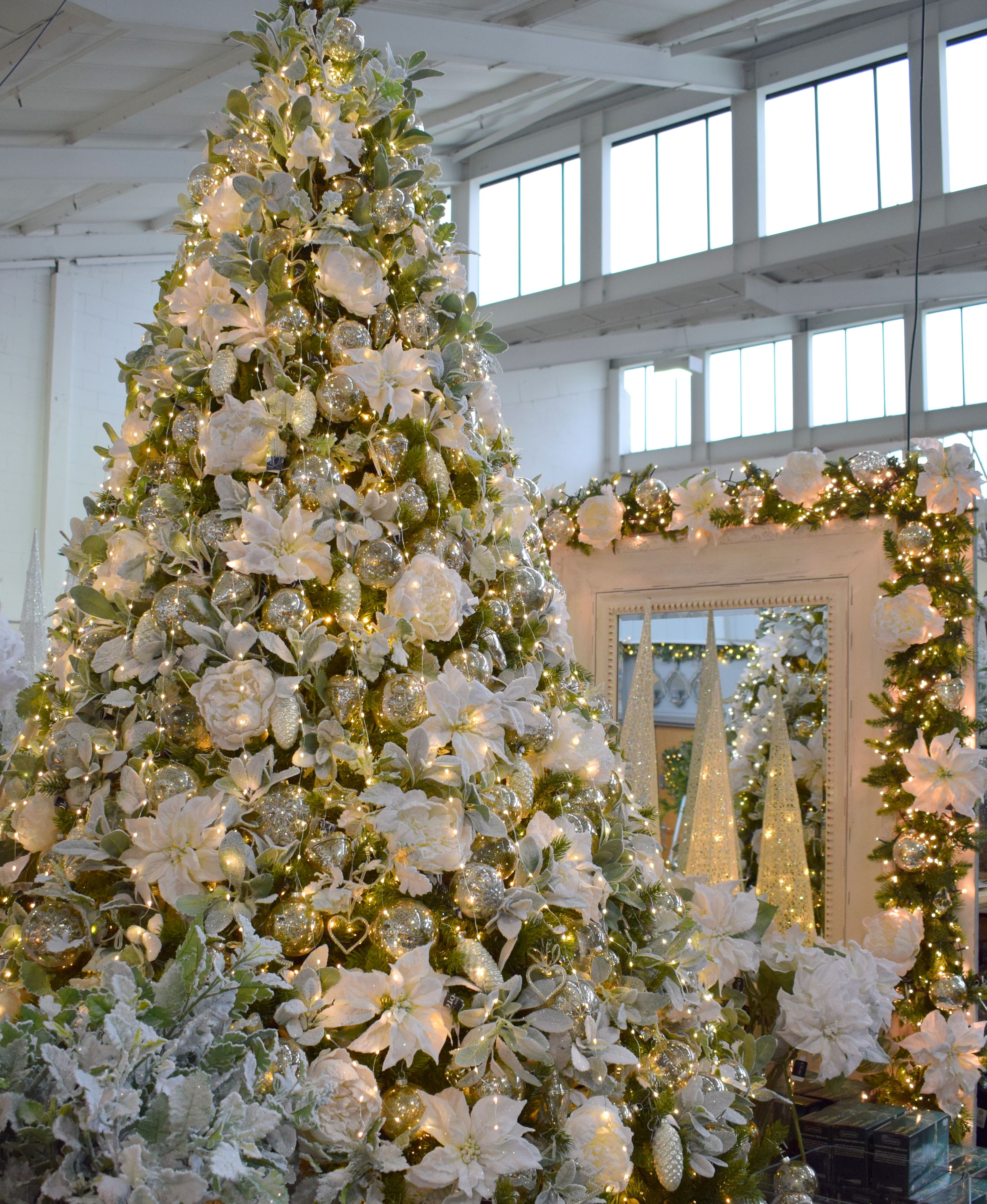 A Stunning Grand Christmas Tree With Fresh Festive Floral Accents Warm White Glow Ligh Christmas Decorations Wholesale Christmas Lights Christmas Decorations