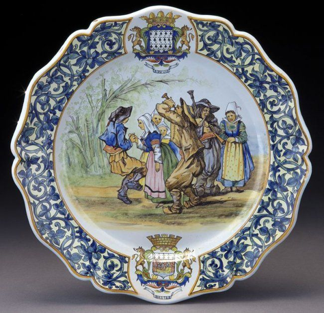 """PB Quimper round platter with hand painted reserve depicting musicians and a dancing couple. Marked """"PB"""" in underglaze black and titled """"Bannalac."""" 13.25"""" Dia., Circa - 1875-1903."""