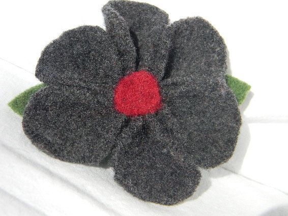These little hair clips are the bees knees. A little flower goes a long way towards cuteness.  http://www.etsy.com/listing/94095410/felted-wool-gray-daisy-pin