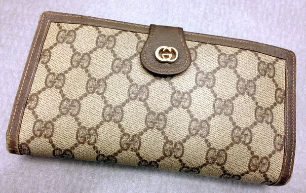 This is Wendy's best ever thrift store find. It's a Gucci continental clutch wallet. It retails today for well over $400. She found it in a bucket of wallets at the Goodwill in Zanesville for only $0.49. (Allison Carey/The Plain Dealer)