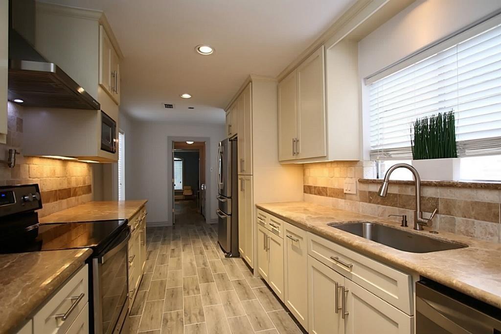 Chef's kitchen has under cabinet lighting, new plumbing ...