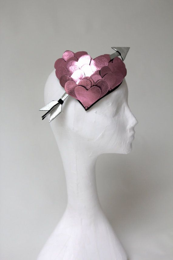 A beautiful pink metallic leather, heart shaped headdress complete with silver leather arrow.    Perfect for a party, performance or