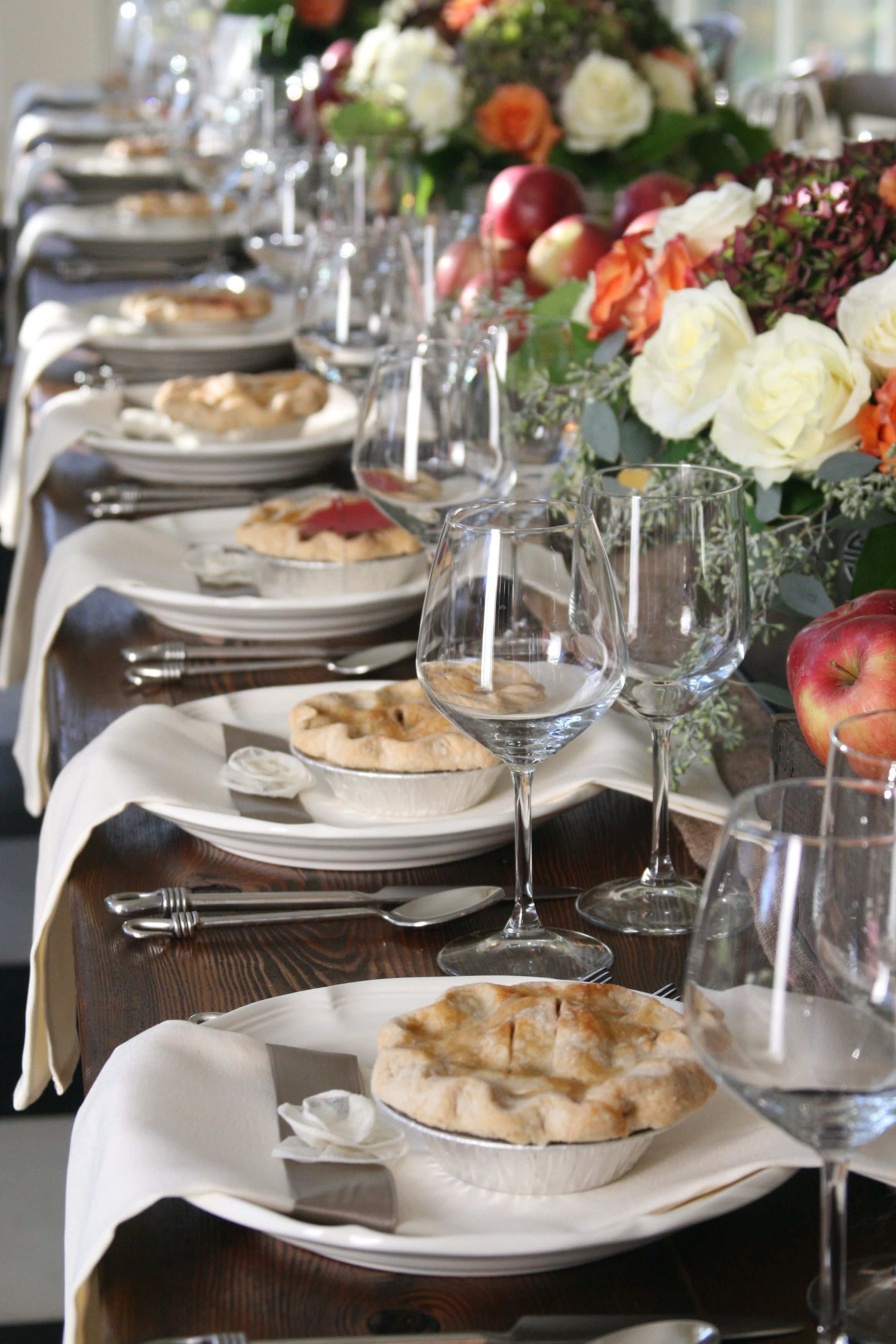 Family-style table setting with mini pie favors | Backyard ...