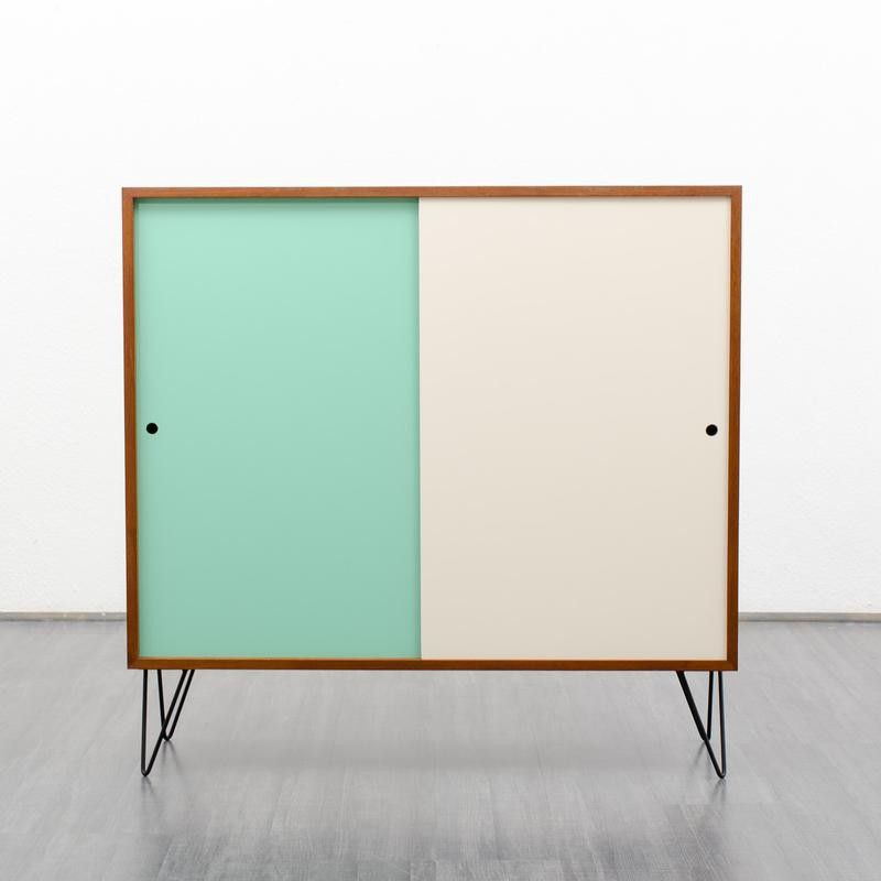 1960s teak cupboard with coloured fronts and hairpin legs | DesignAddict