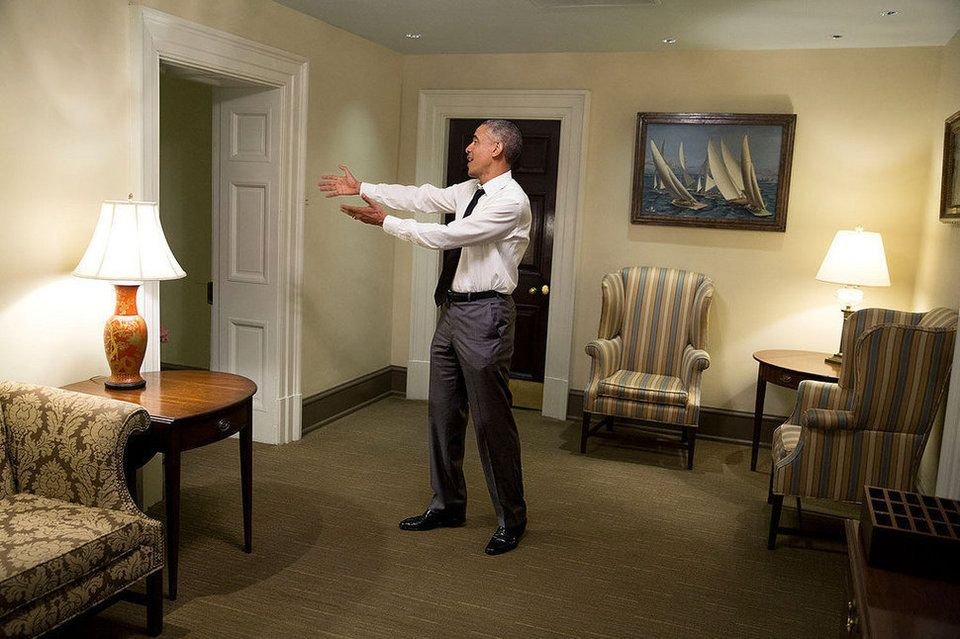 president obama gestures to a departing guest in a hallway of the rh br pinterest com