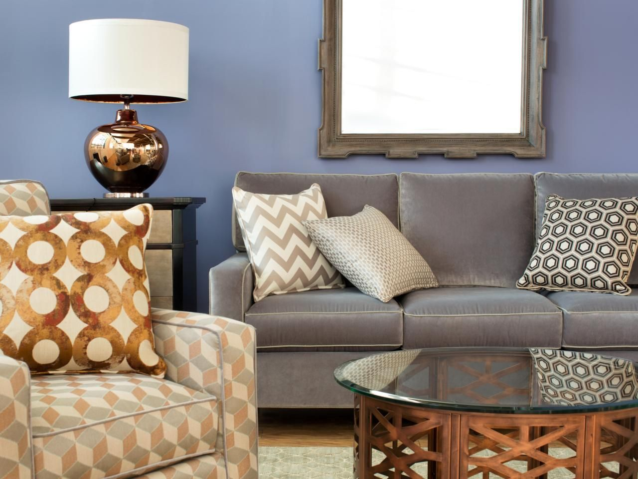 living room showcase designs%0A Cozy and relaxed  this eclectic living room pairs a solid gray sofa with a  graphic