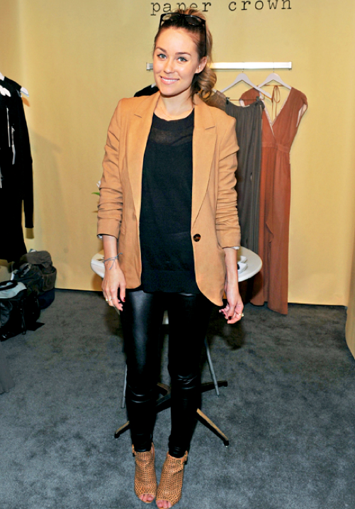 #LaurenConrad is a prime example of someone who can blend different styles together and always look put together. Here she's rocking a fall fashion favorite, leather pants, with open-toed booties and a camel-colored blazer.