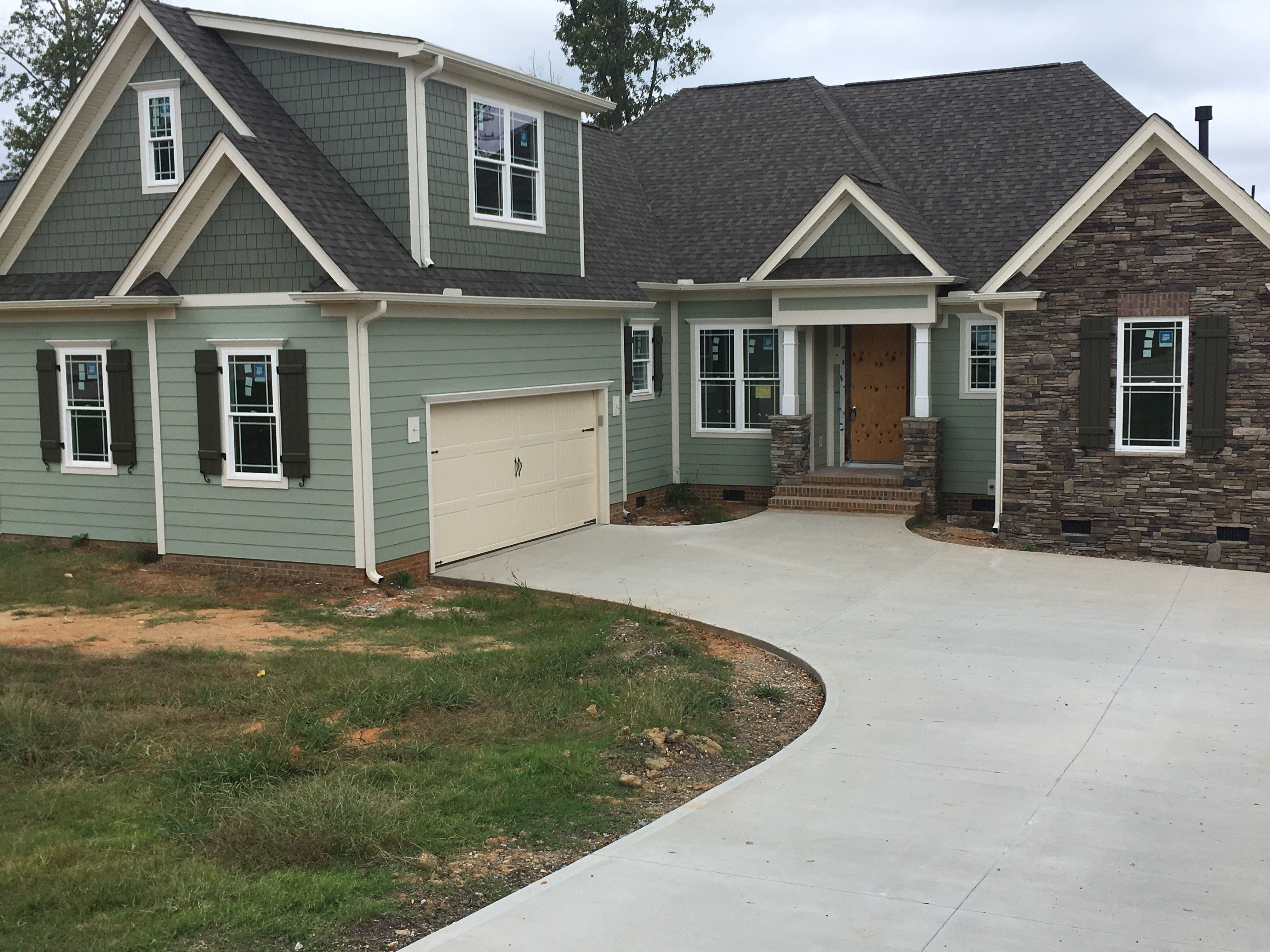 Newly Build Craftsman Style Home With Composite Exterior Shutters