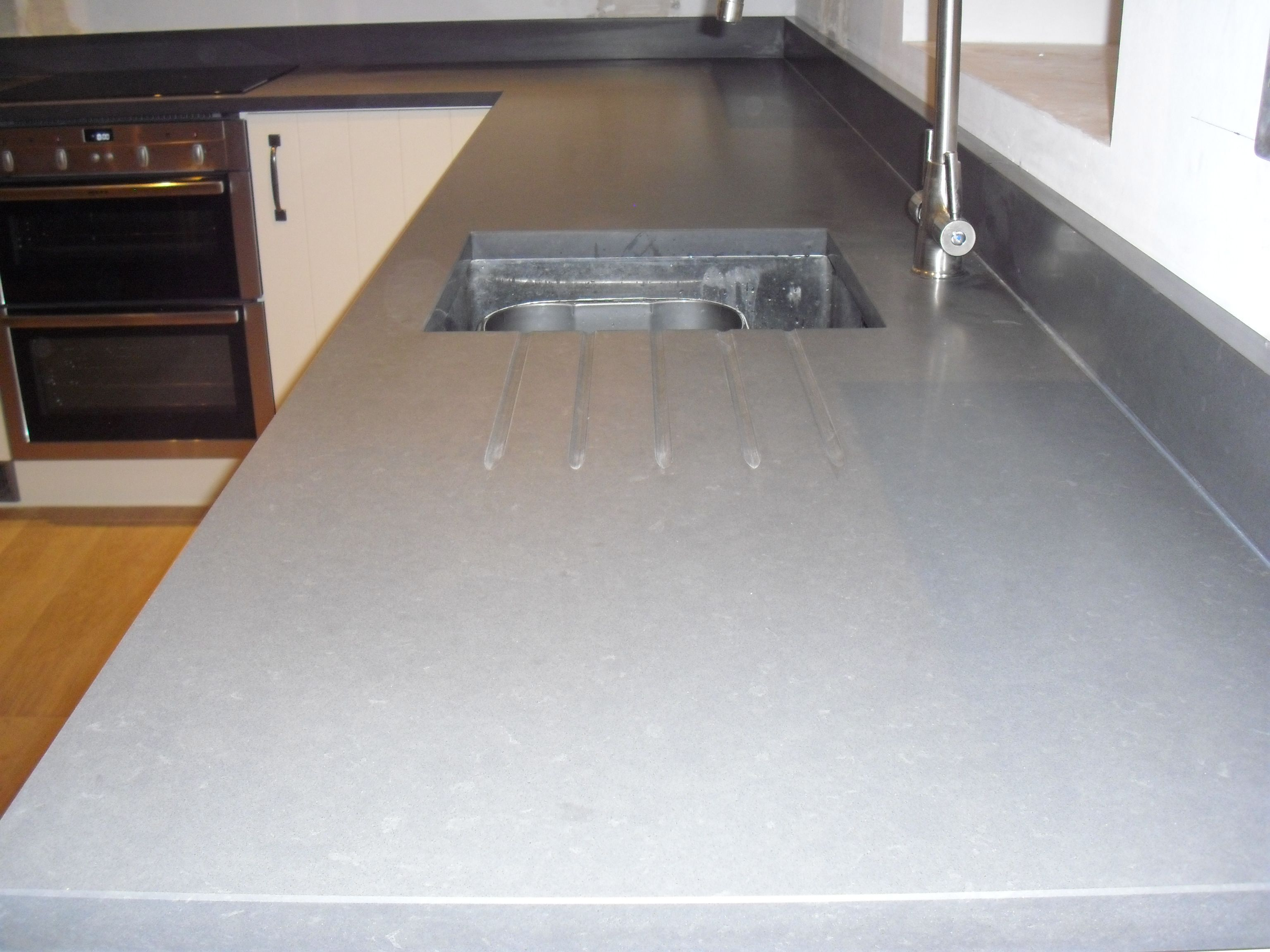 Honed Quartz Countertops This Raven Quartz In A Honed Finish By Caesarstone Looks
