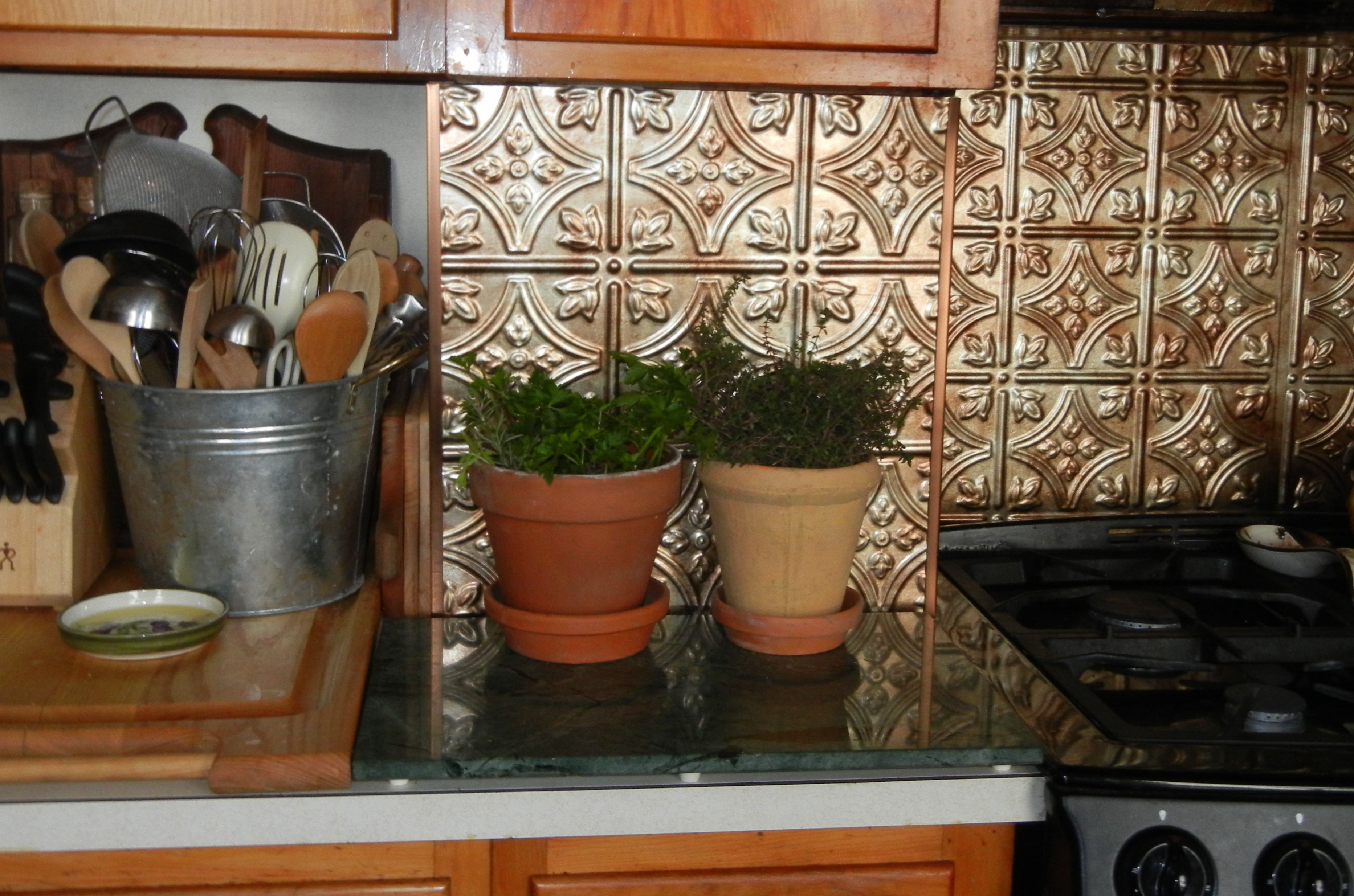 Working on updating the kitchen with color, contrast and texture making it a cook's haven.