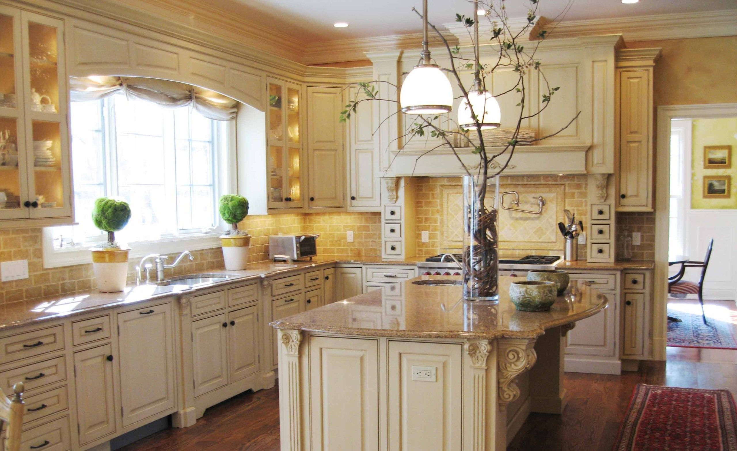 Terrific French Country Kitchen Decor With Broken White Cabinets And Island Combined With Gold Wall Paint