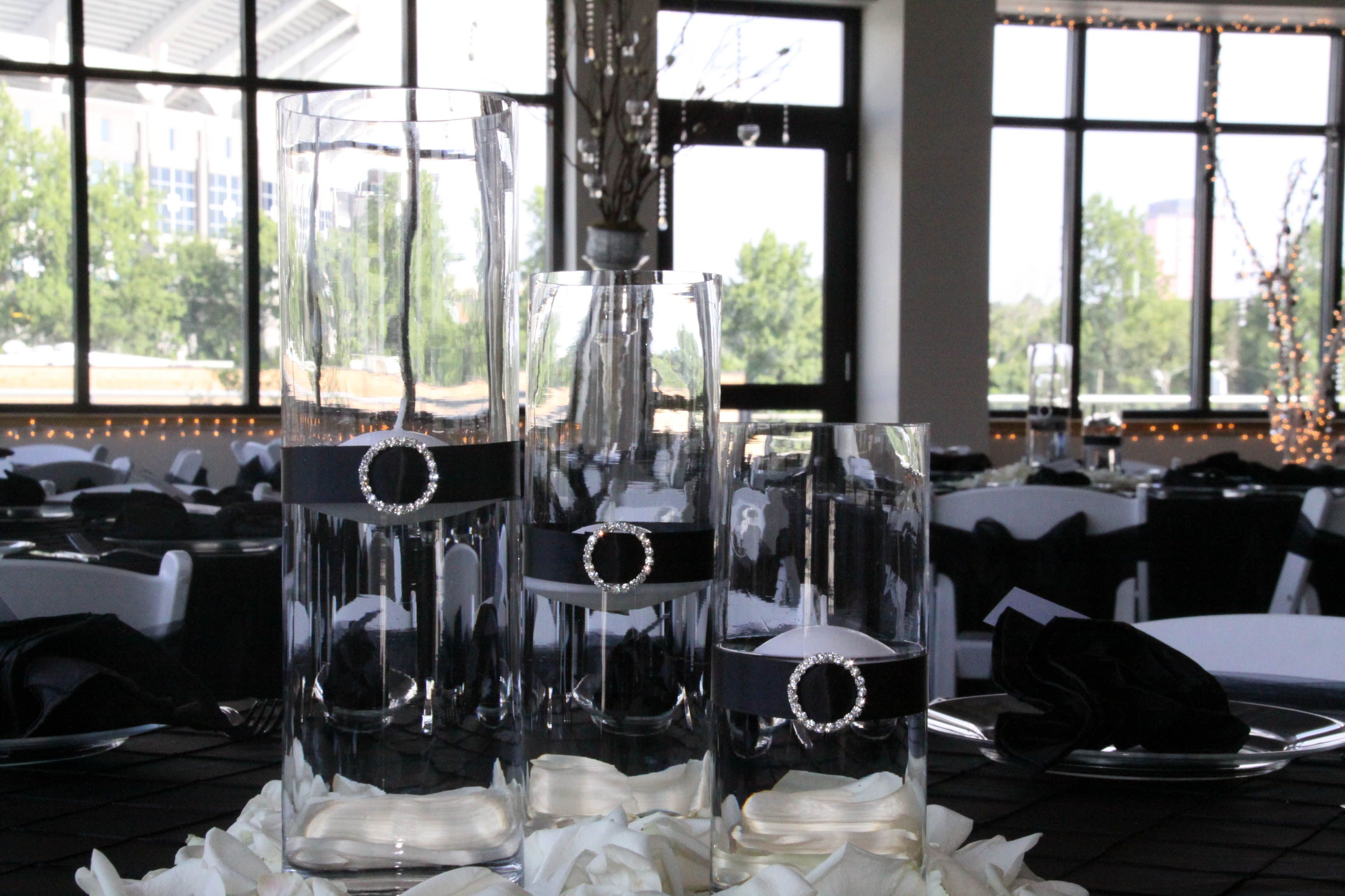 centerpieces for wedding receptions with candles%0A   Glass Cylinder Wedding Centerpiece with Floating Candles and Black Ribbon  surrounded by White Rose Petals
