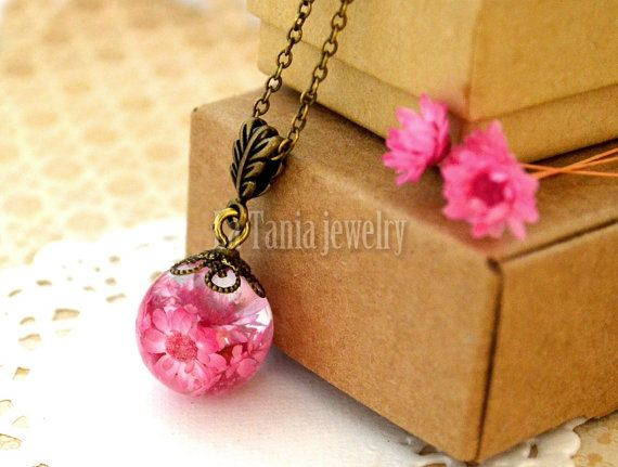 Handcrafted nature inspired resin necklace featuring four of pink beautiful dried flowers encased in non toxic resin orb. The classy necklace is
