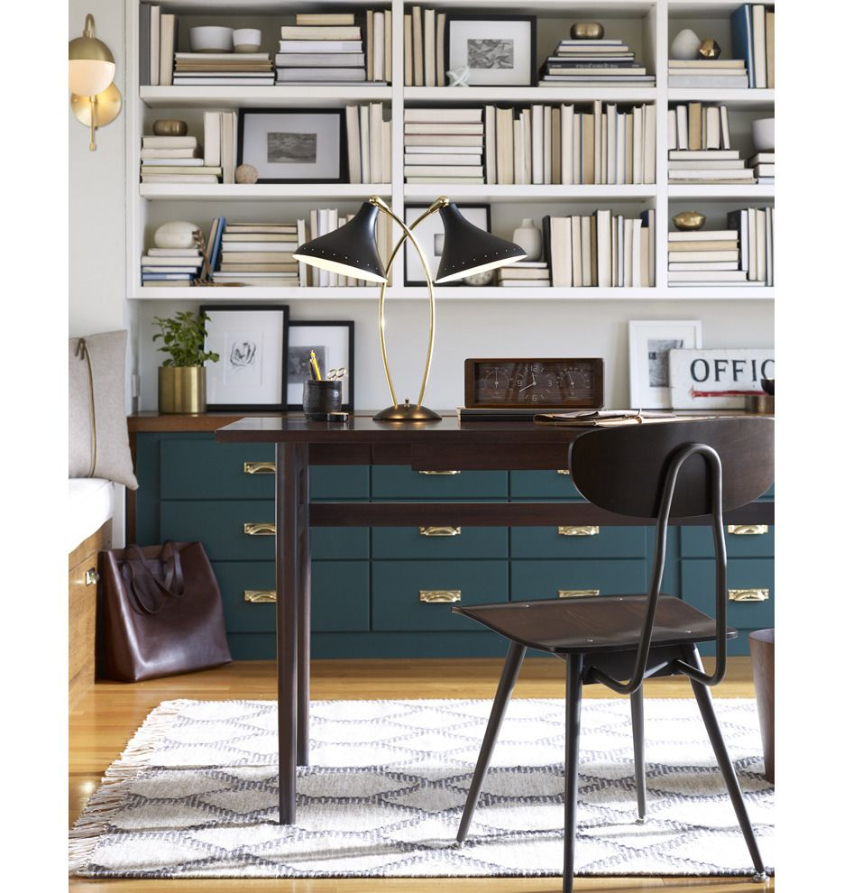 I love the gold wall sconce on the wall in the far corner and the stylish table lamp. The cabinet is pretty as well! Cedar & Moss Sconce | Rejuvenation