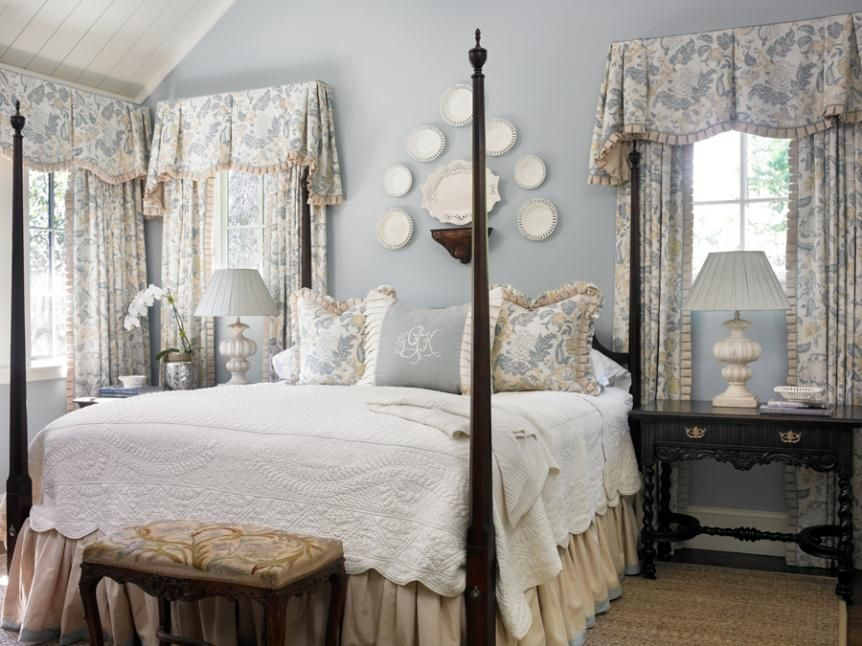 Traditional bedroom with 4 poster and softly printed valances with