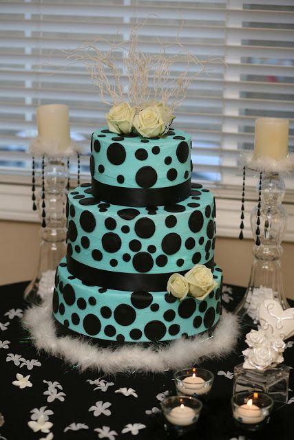 Love the ribbon, dots and colour. On black is a wonderful unique cake.