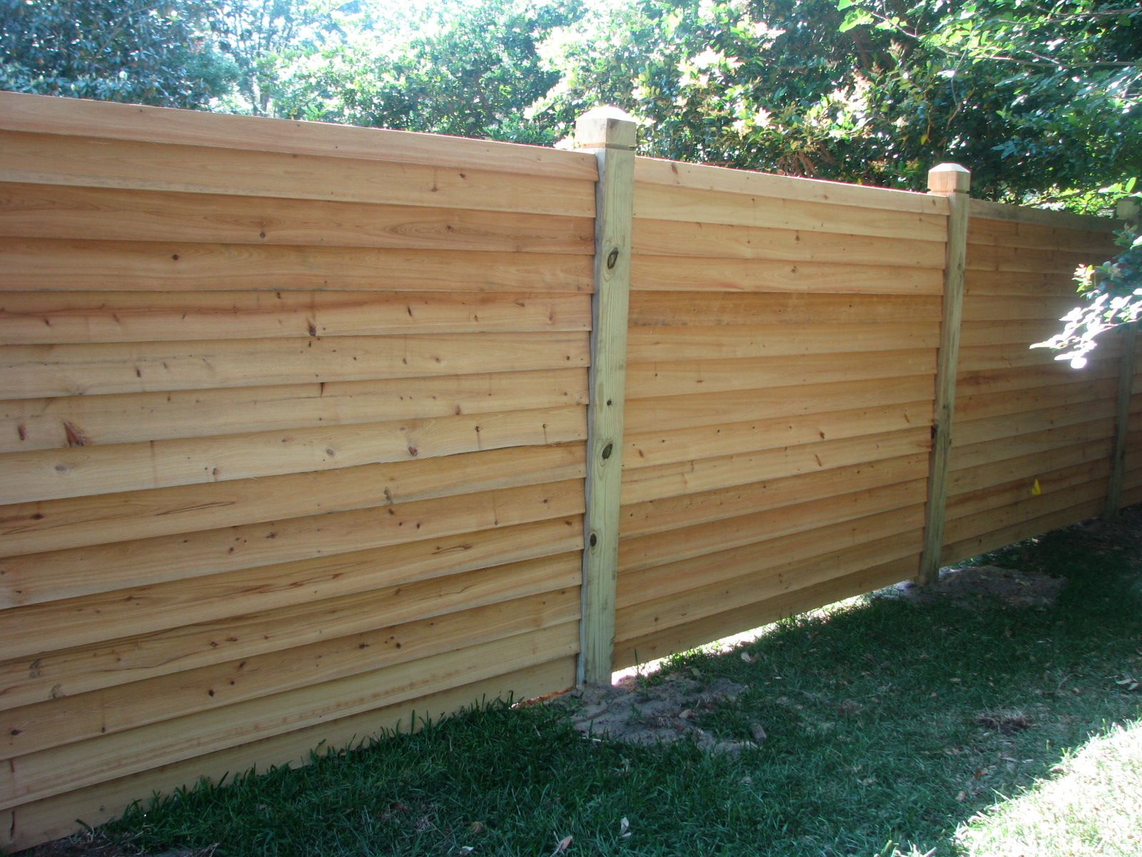Custom horizontal wood privacy fence by Mossy